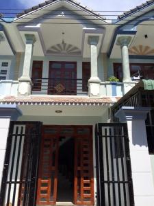 Nhà đất  Dĩ An giá rẻ bán gấp nhà lầu kế bên Uỷ Ban, trường Học